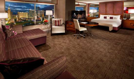 mgm-grand-hotel-rooms-executive-king-interior-living-room-bedroom-city-view-@2x.jpg.image.550.325.high