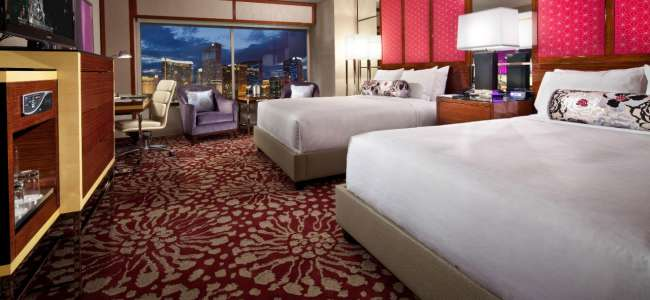 mgm-grand-hotel-rooms-stay-well-grand-queen-bedroom-bed-city-view-@2x.jpg.image.650.300.high