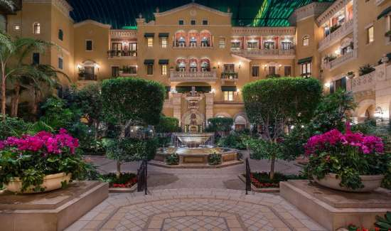 mgm-grand-hotel-rooms-mansion-exterior-atrium-night-light-water-fountain-hero-shot-@2x.jpg.image.550.325.high